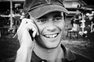 man-talking-on-cell-phone-baseball-cap