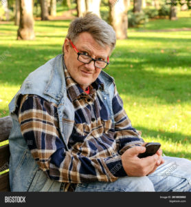 middle-aged-man-with-cell-phone-outdoors.